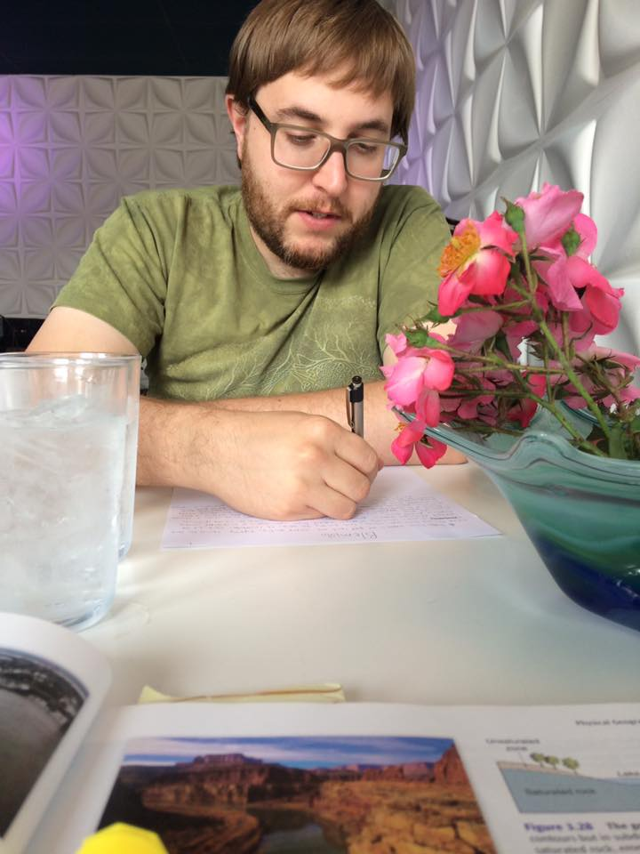 Randal Eldon Greene writing at the Blue Cafe in Sioux City Iowa.