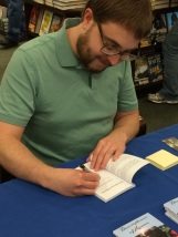 Literary Fiction author Randal Eldon Greene signing his debut book Descriptions of Heaven.