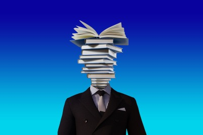 "man in suite with a head ""full"" of books"